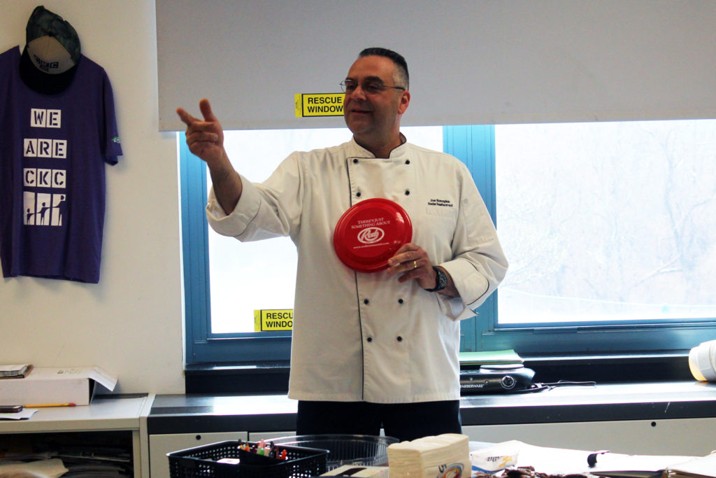 CHef talking to students