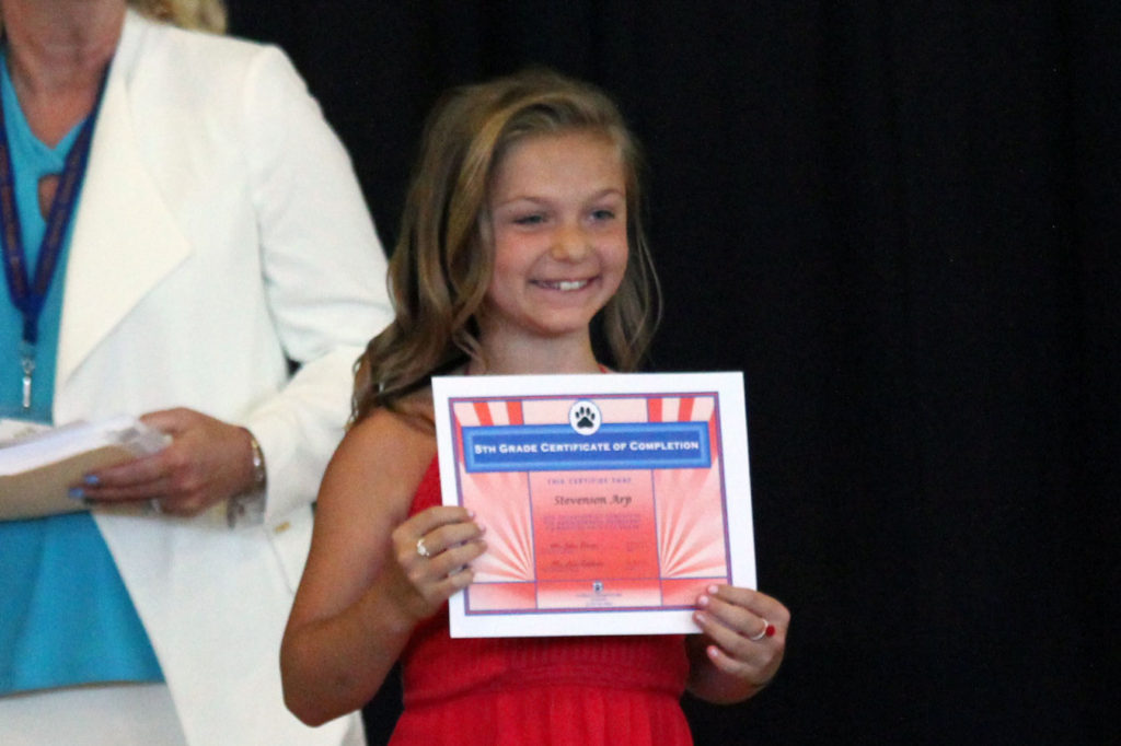 Girl with moving up certificate