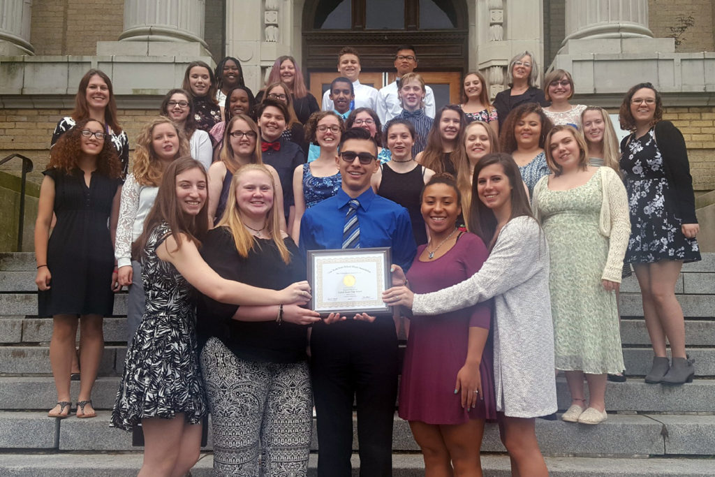 Concert Chorus with their Gold certificate on the steps of Kingston High School