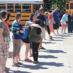 CMS staff wave and give out hugs as students leave for summer break