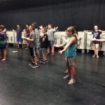 Music campers rehearsing for their upcoming musical on the CHS stage