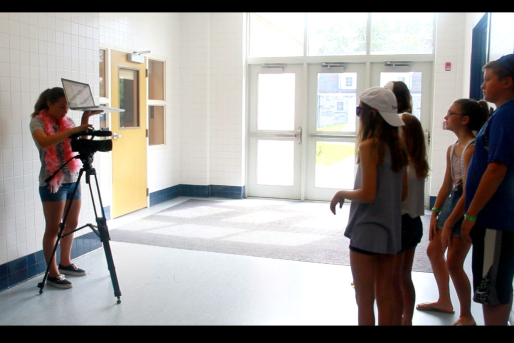 students filming scene for their movie