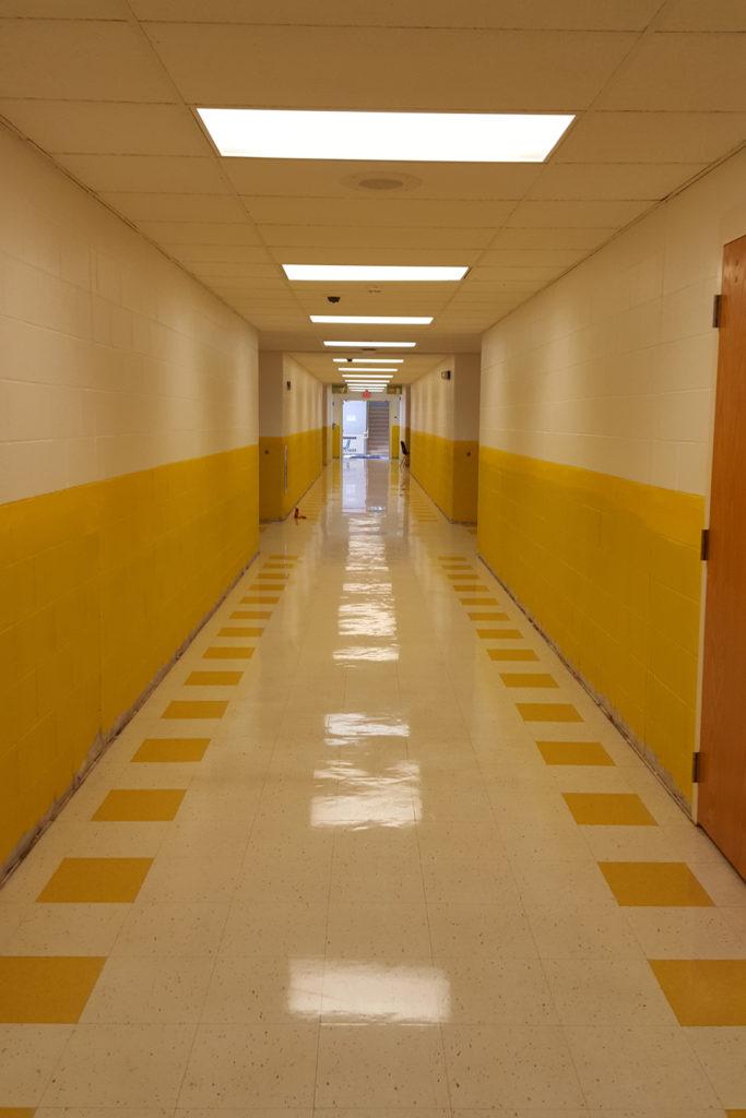 freshly painted yellow hallway