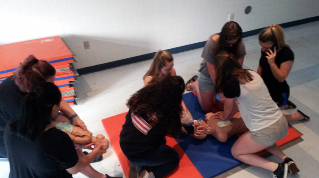 learning/administering CPR and calling 911.
