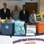 William Bartholomew, Coach Doug Lampman, Justice Brantley and Ashley Shook with items they collected.