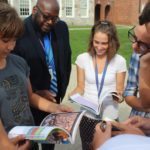 students and staff peruse the new books