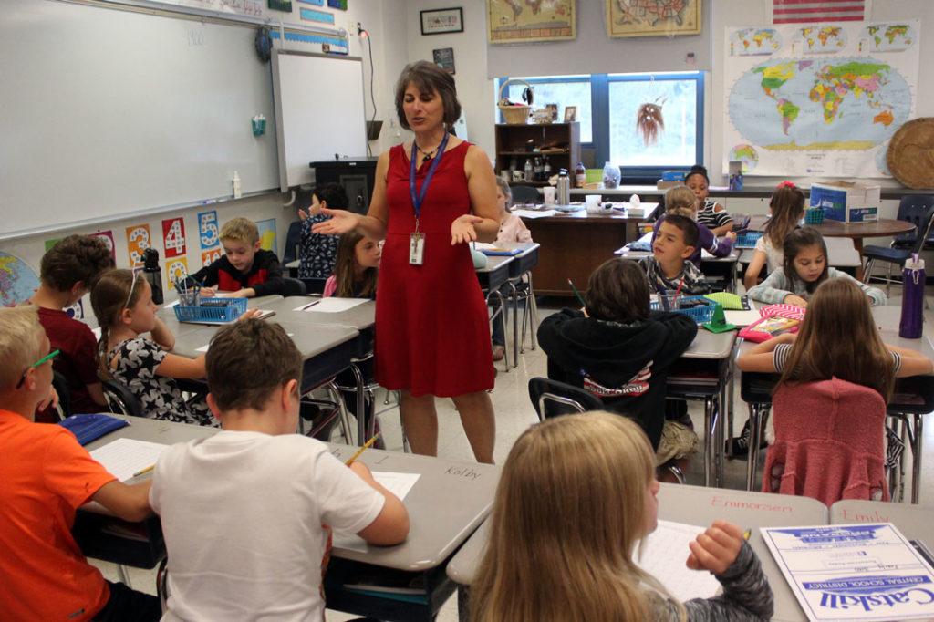 teacher teaching class at the elementary school