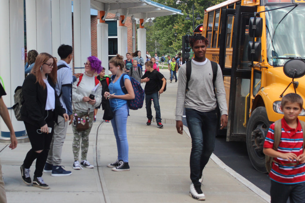 high school students head to the bus