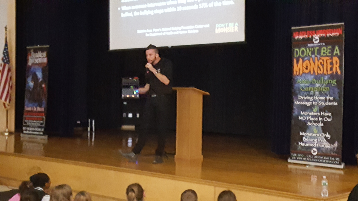 illusionist performs for students