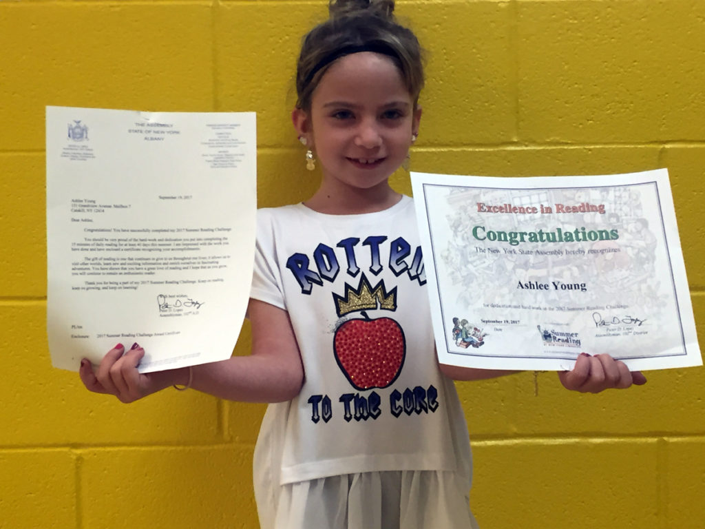 Ashlee Young with congratulatory certificate and letter from assemblyman Pete Lopez