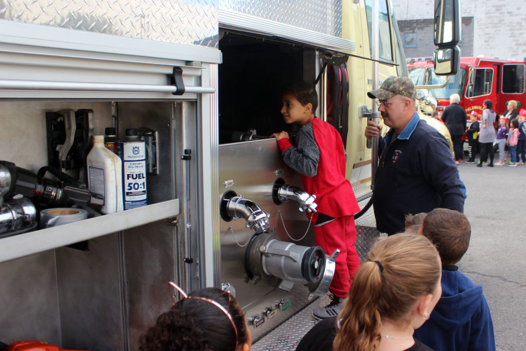 Student looks inside pumper