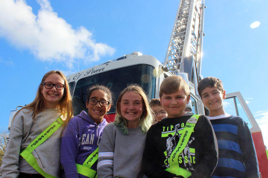 safety patrol poses infront of the ladder truck
