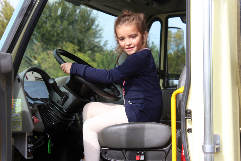 Girl behind the wheel of a fire tuck