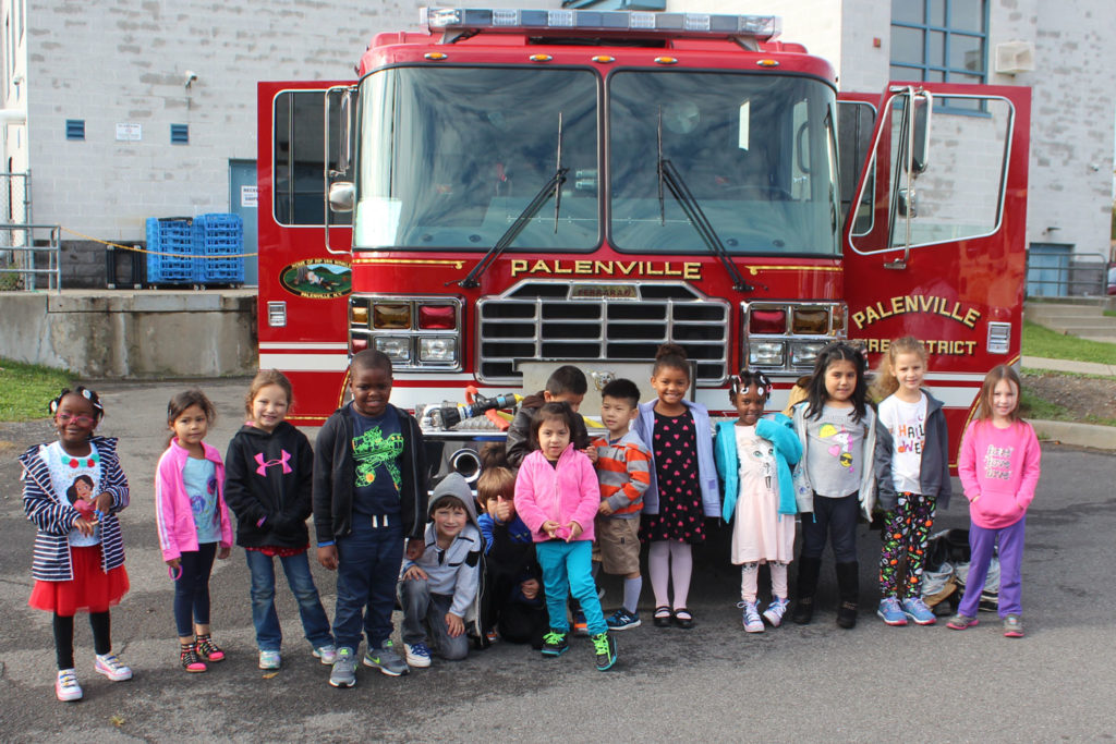Kindergartners pose with fire truck