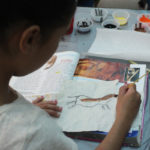 students painting animal in cave painting style