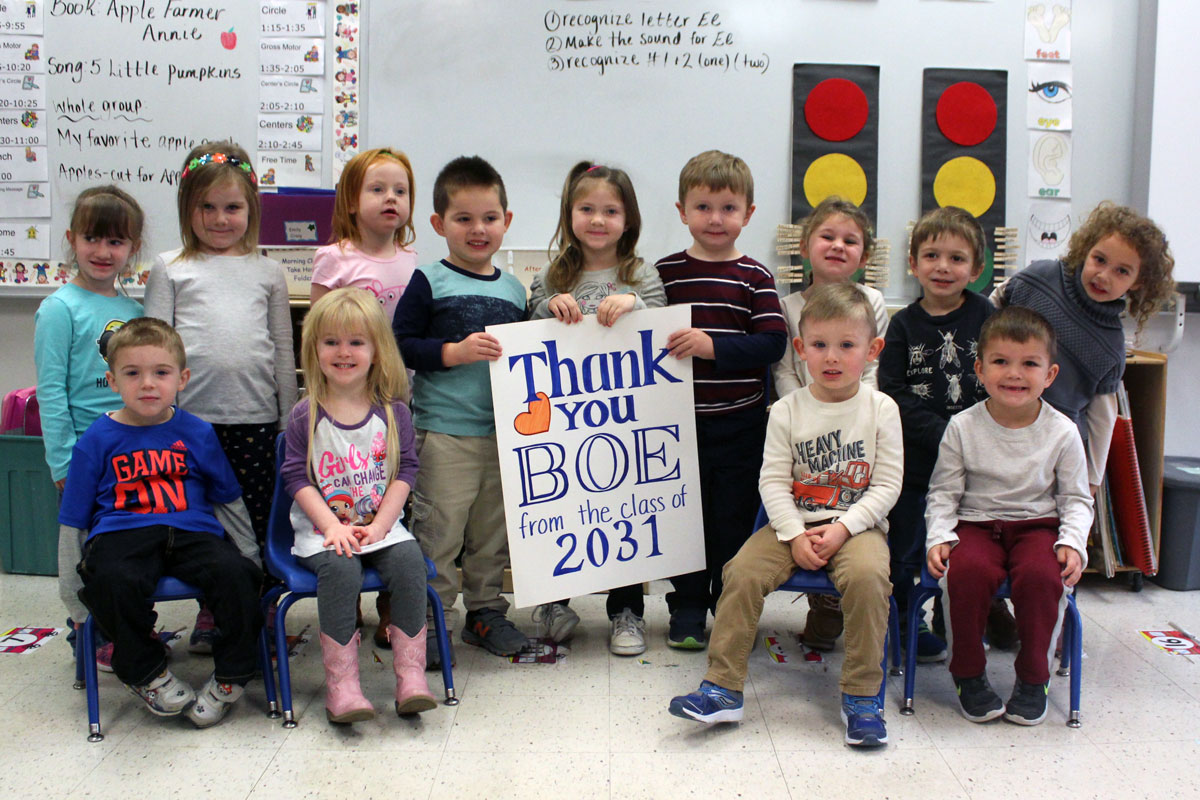 Pre-K students pose with sign that says thanks you BOE from the class of 2031
