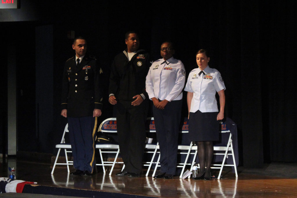 active duty servicemen and women on stage at CHS