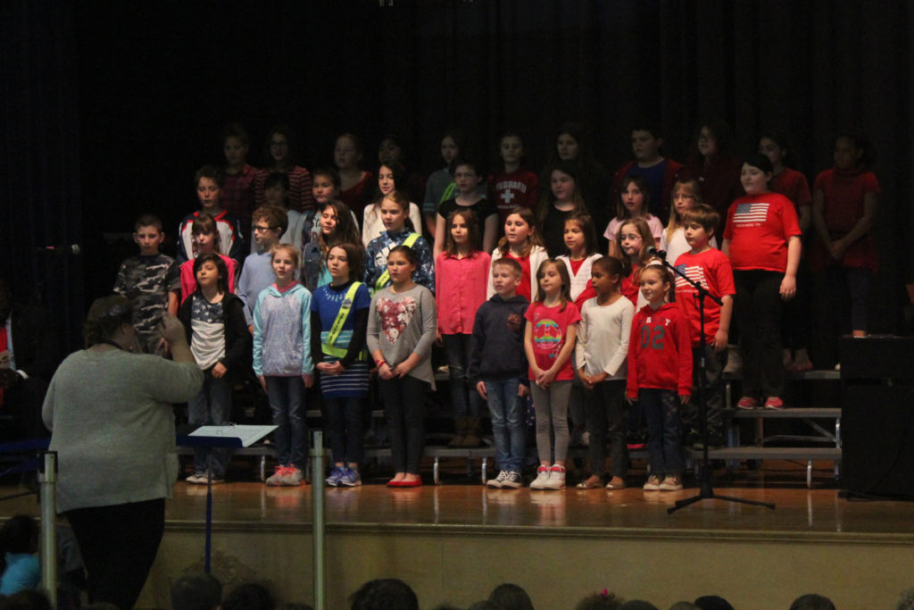 CES Chorus sings on stage
