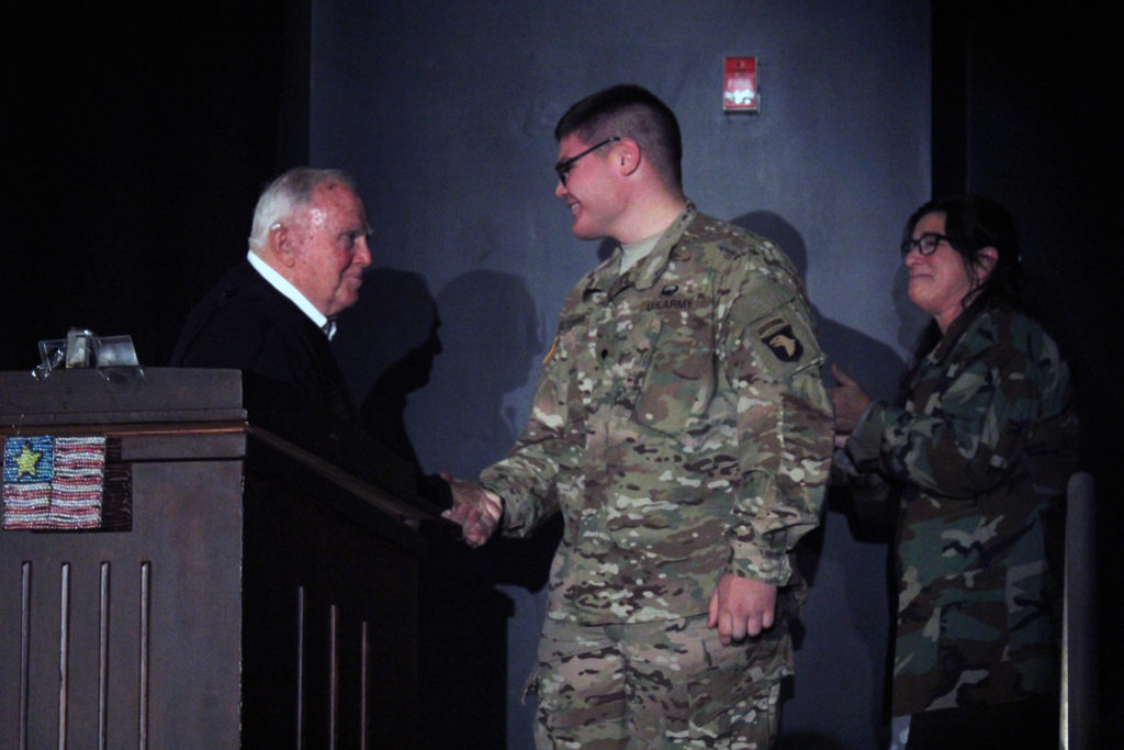 Mr. Schloss shakes hands with his grandson Nathan Bitternman