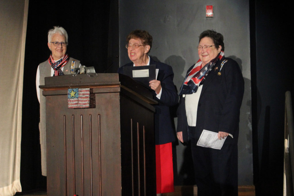 representatives from the Daughters of the American Revolution on stage
