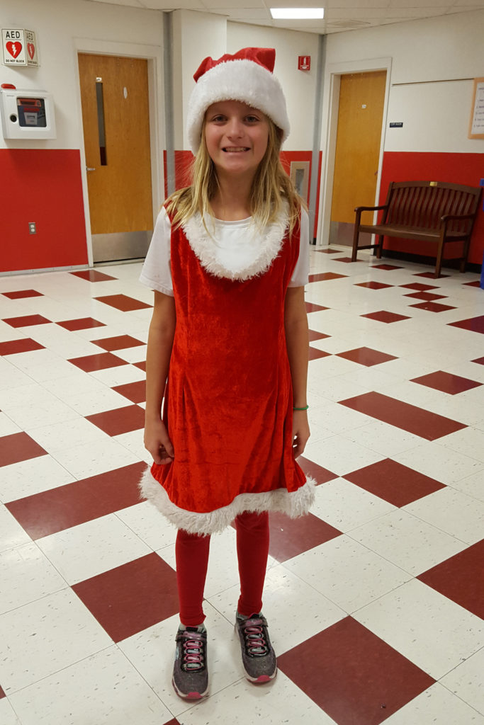 girl in Santa hat and dress