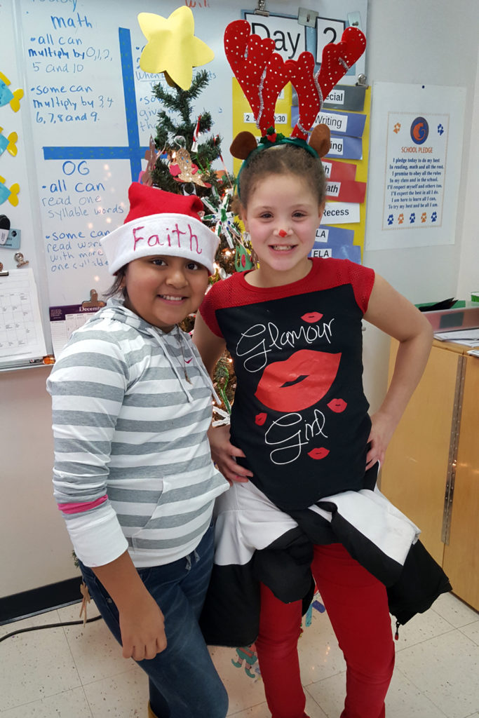 girl with santa hat and girl with antlers