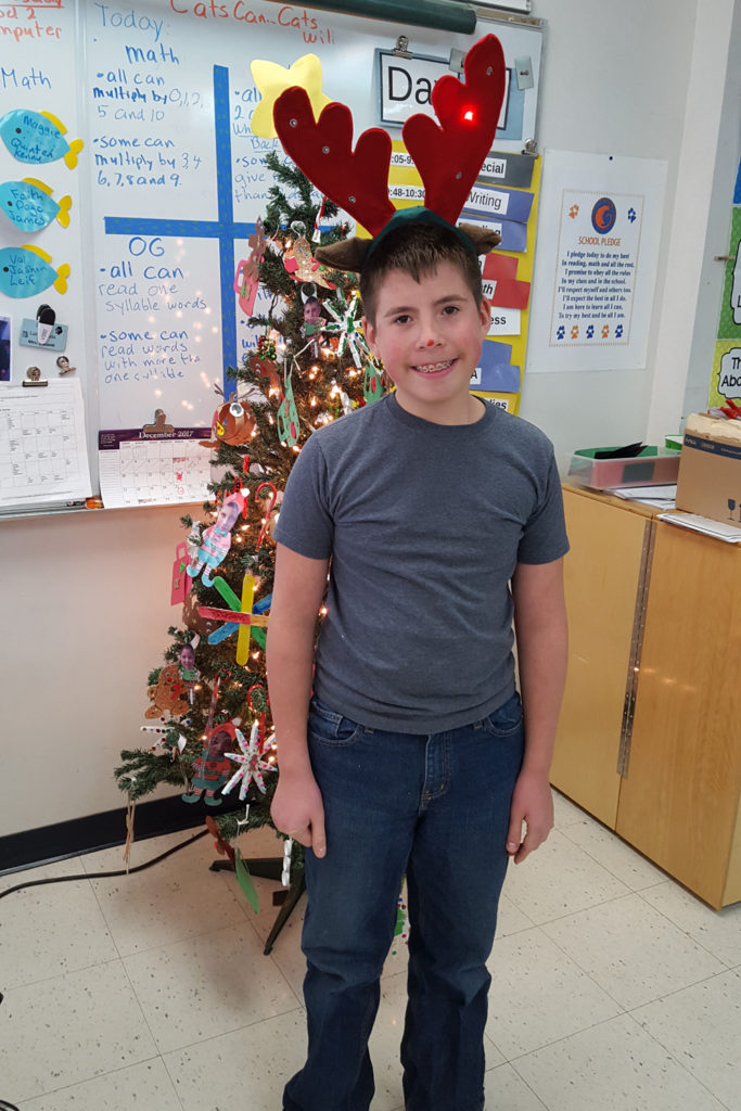 student with antlers
