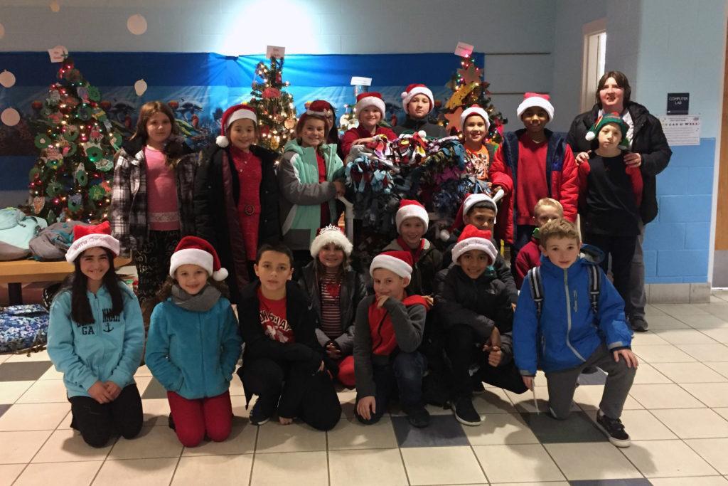 CES student council poses wearing Santa Hats