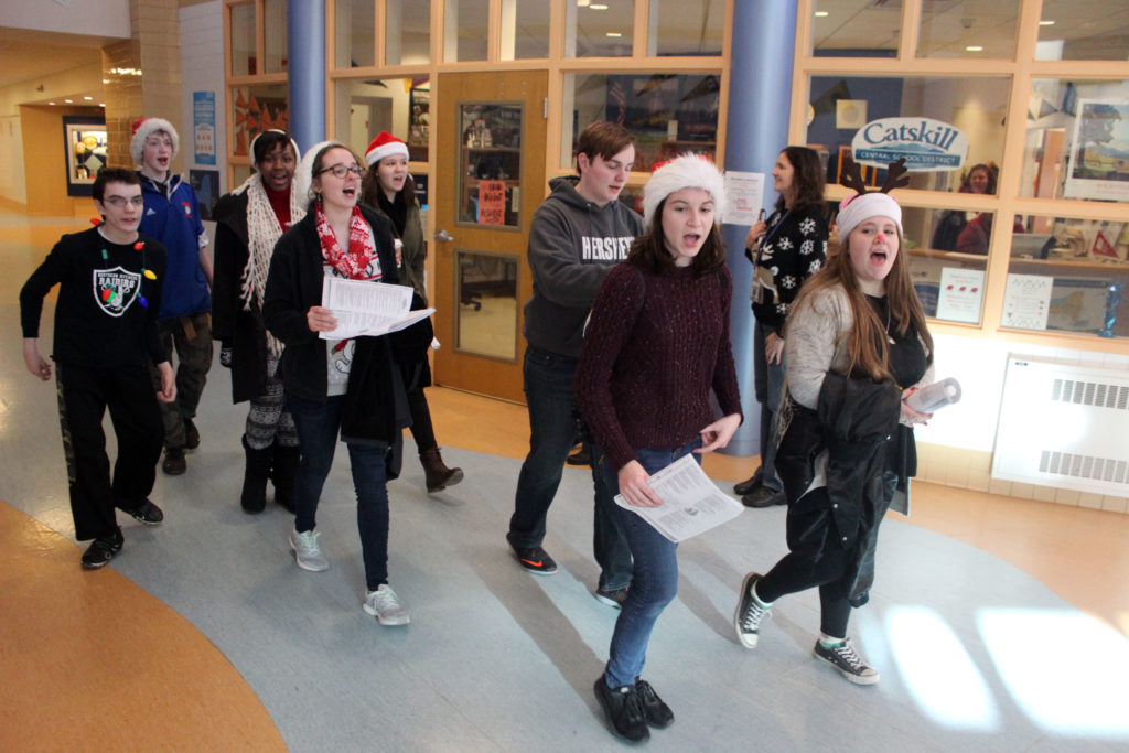 Carolers sing in the halls of CHS