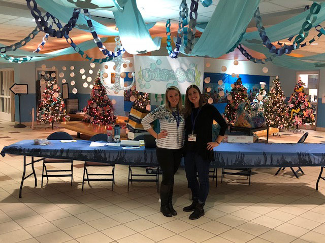 Two teachers pose with undersea decorations