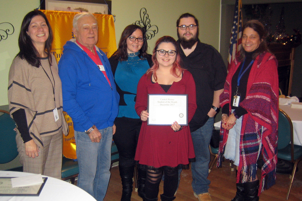 The honor also includes a free lunch. Pictured left to right are Catskill Rotary President Heather Bagshaw, Awards Chair Roger Lane, Chrystal DiRaffaele, Student of the Month Raven DiRaffaele, John DiRafaele, and Middle School Guidance Counselor Beth Daly.