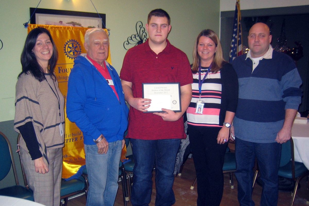 Pictured left to right are Catskill Rotary President Heather Bagshaw, Awards Chair Roger Lane, Student of the Month John Michael Dedrick, Christa Dedrick, and Michael Dedrick.