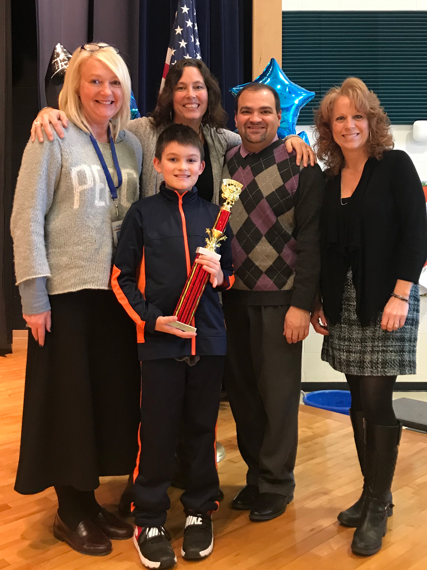 CES Spelling Bee Champion Billy McMullen is joined by (left to right) Mrs. Lisa Schlenker, Catskill Elementary School Assistant Principal, and Catskill Elementary School teachers and Spelling Bee Committee members Mrs. Alexandra Standish, Mr. Matthew Luvera, Mrs. Heather Schindler.