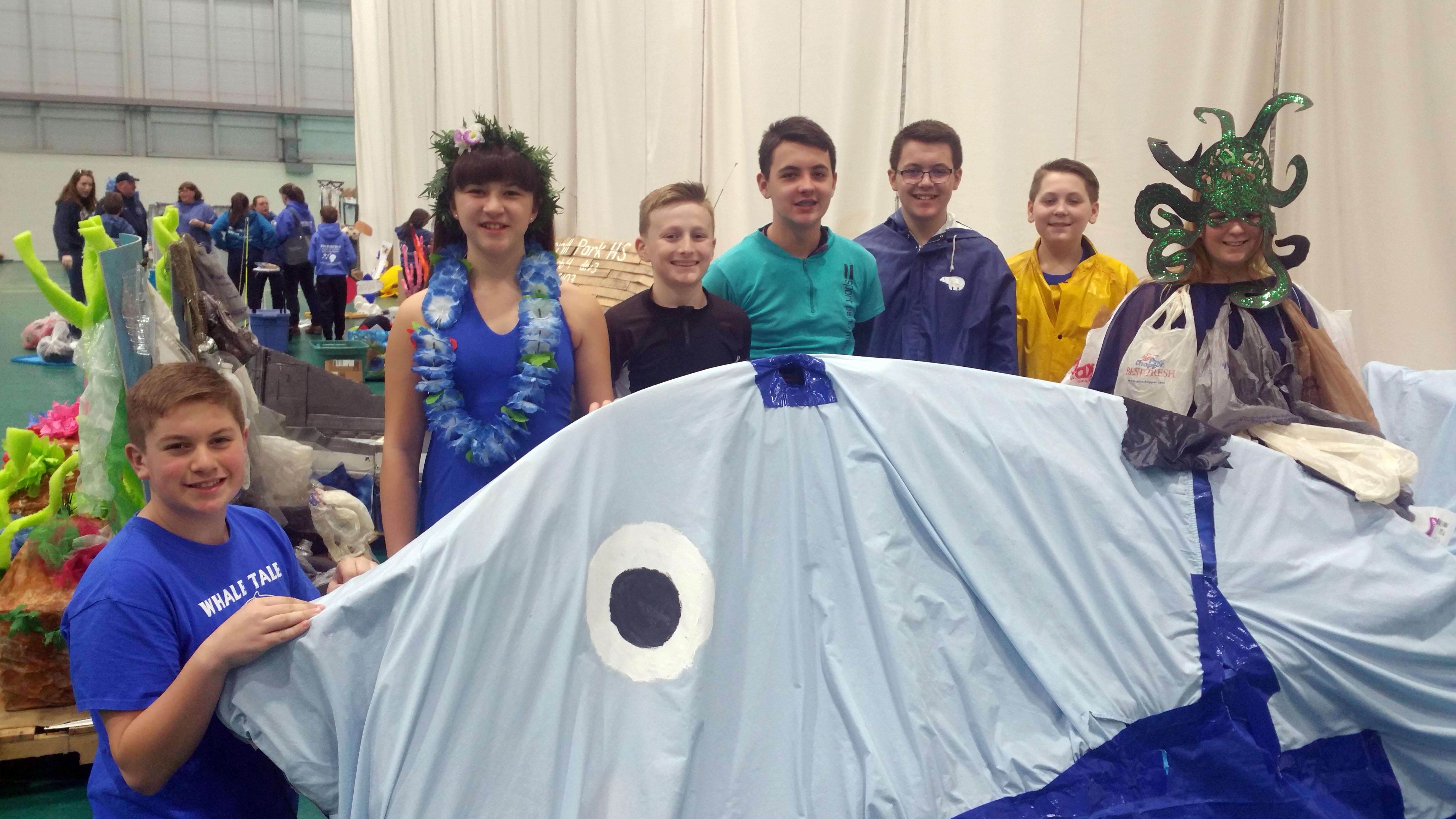 team whale tale poses with thier creation at state odyssey of the mind