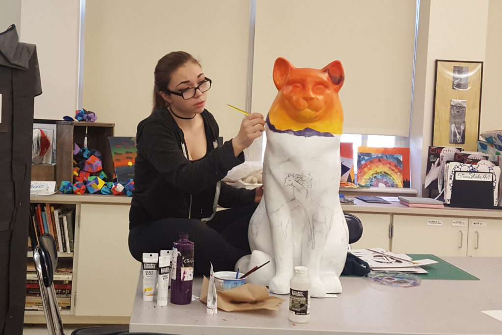 Student painting Cat