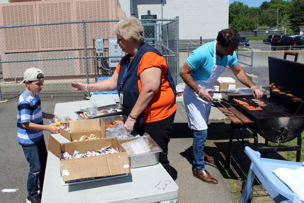 food service workers grilling up lunch