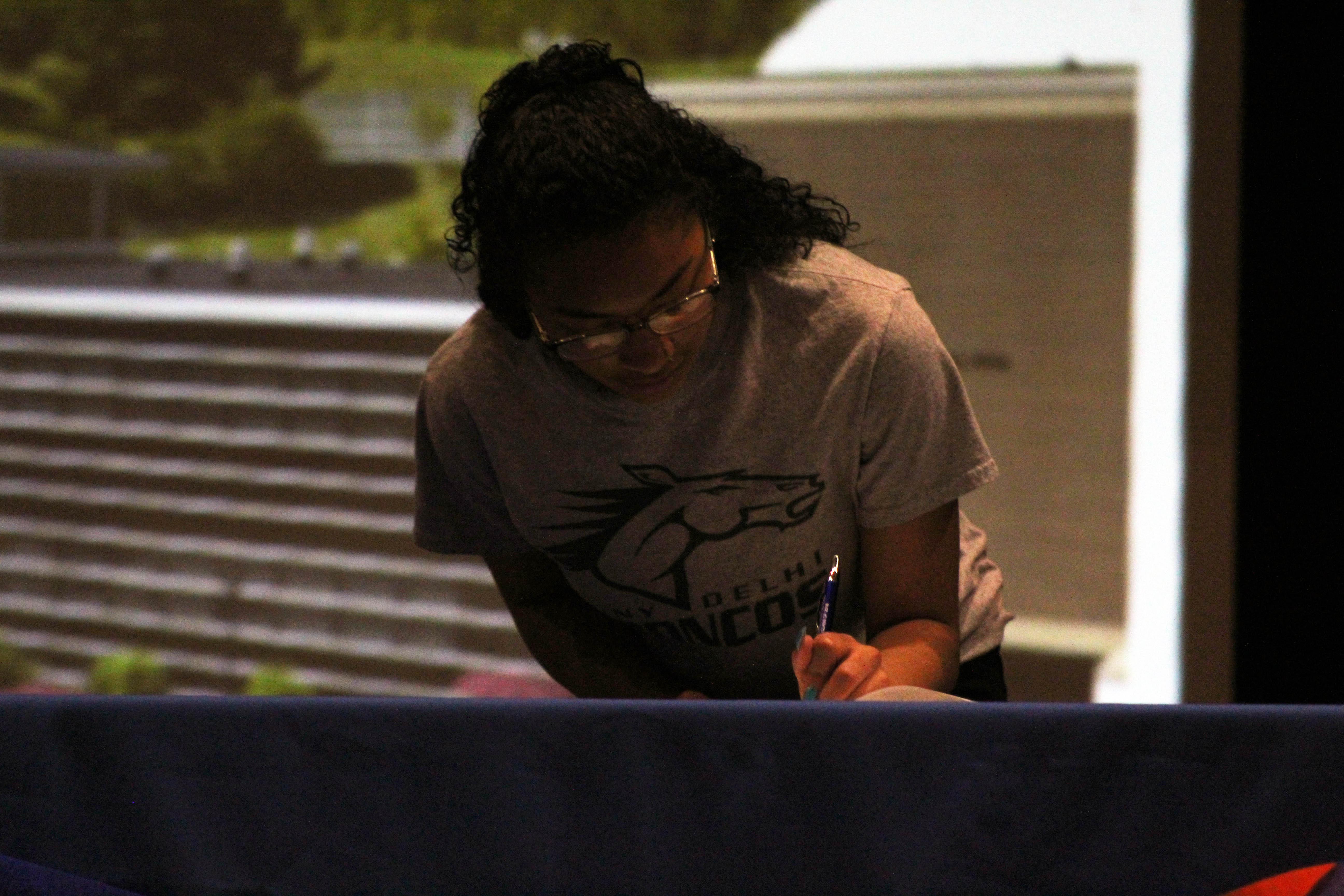 girls signing on senior signing day