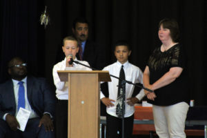 student speaks to audience at podium