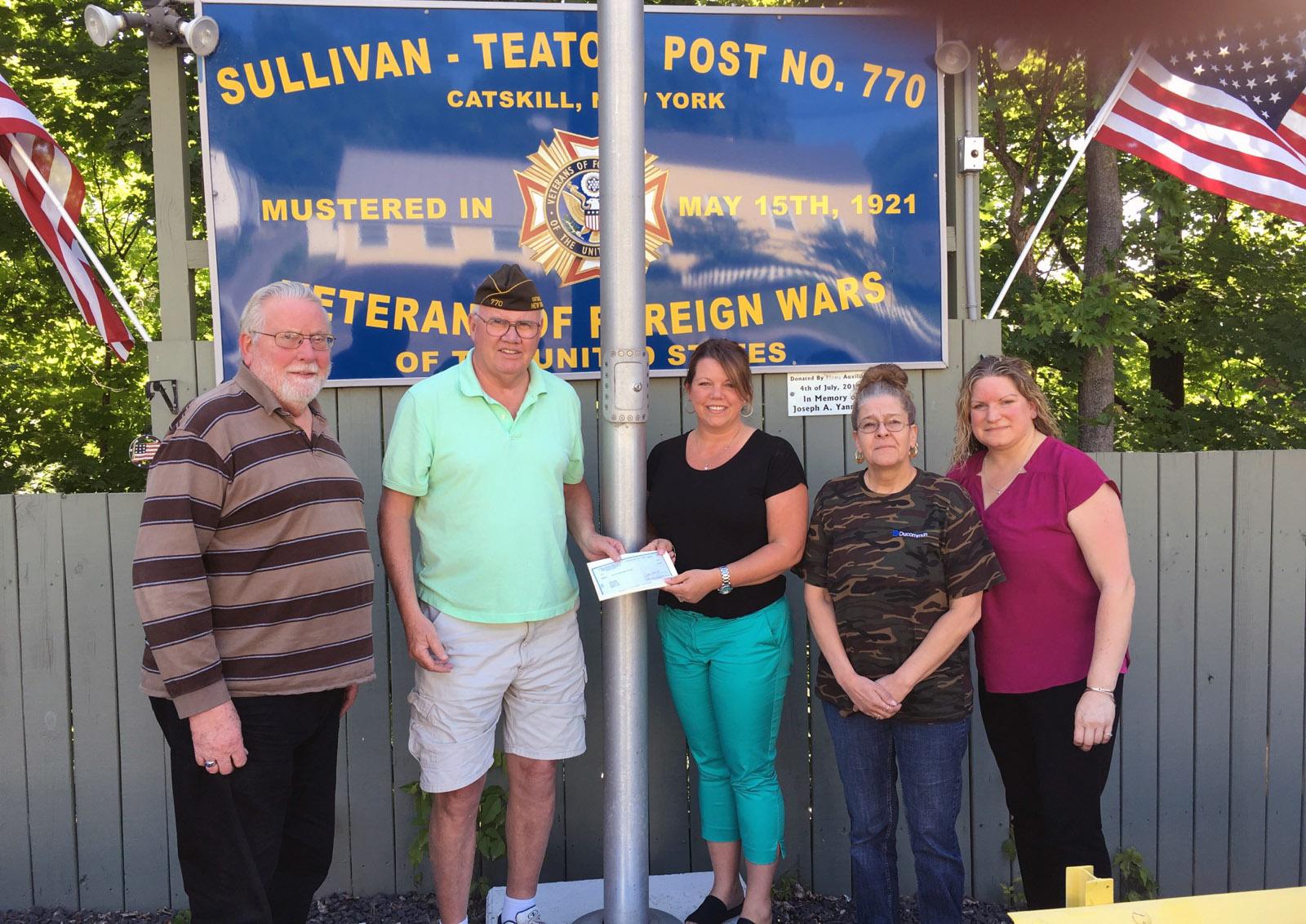 Christa Dedrick hands check to veterans