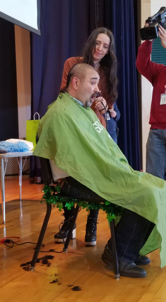 Mr. Rivers has his head shaved by Chris Mercan