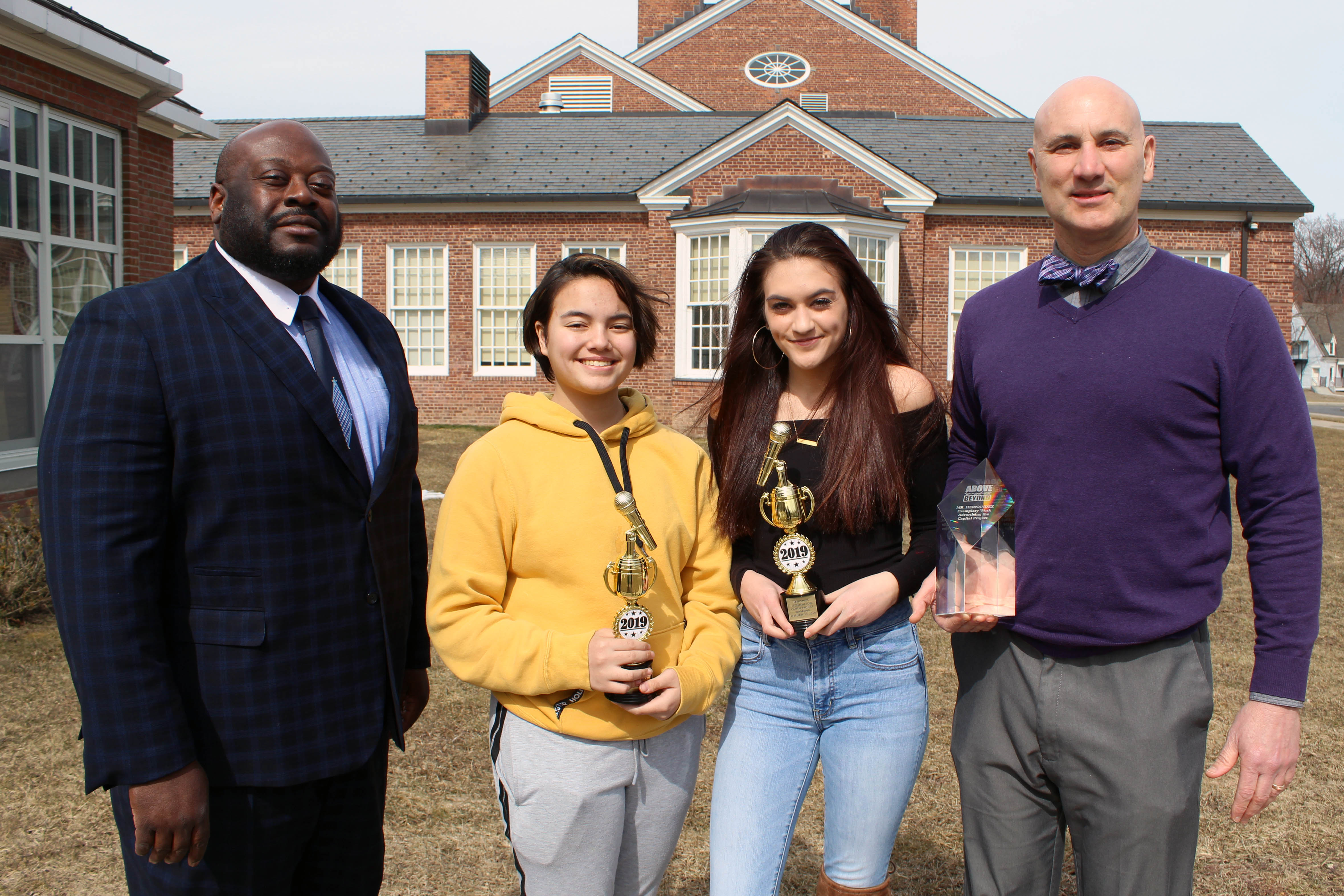 Dr. Cook, reporters Mya Hernandez and Lexi Davies, and media teacher Patrick Hernandez with their awards