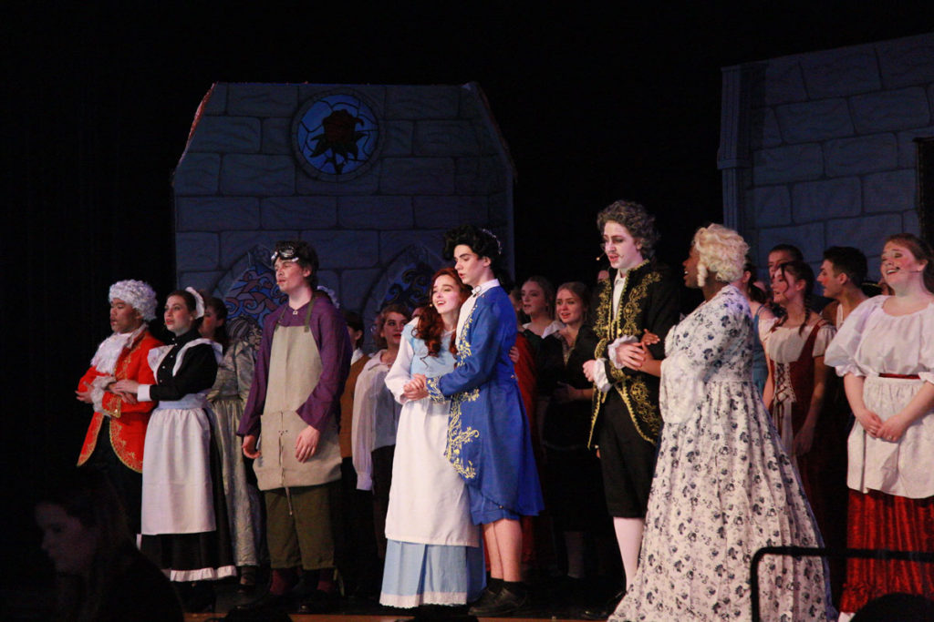 Belle, the prince, the house servants, and townsfolk celebrate