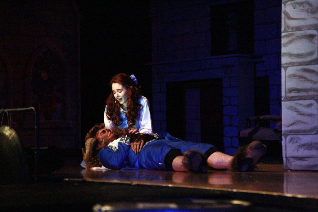 Belle kneeling over the beast
