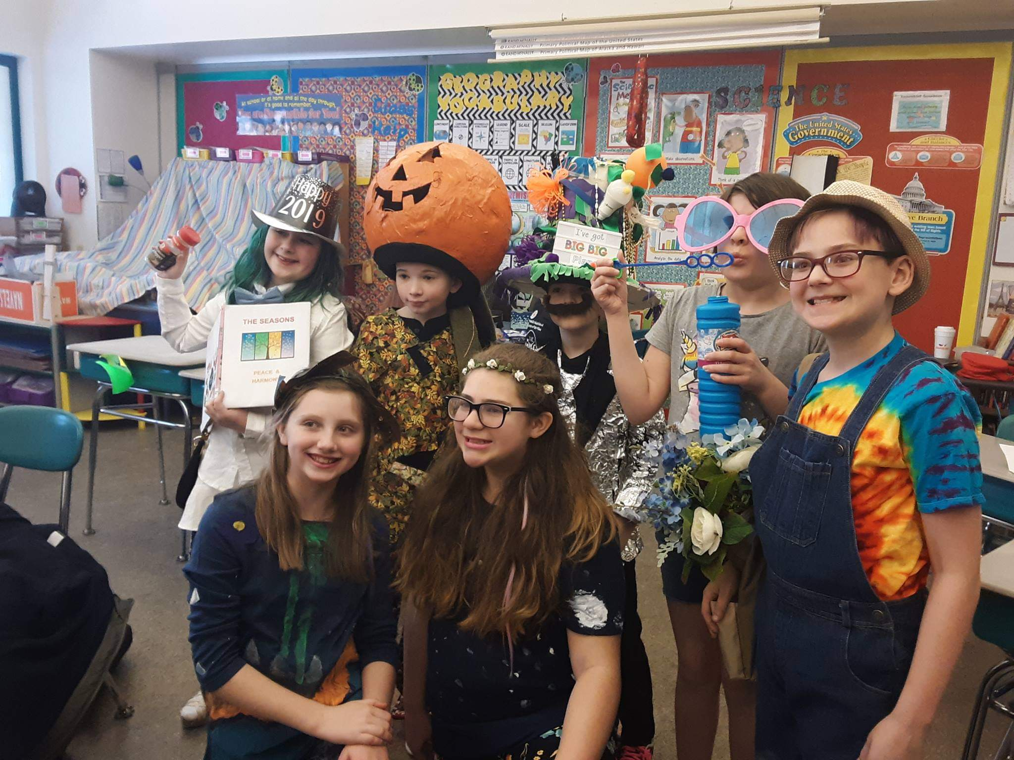 team dressed up as the four seasons, Mother Nature, and Mother Peace