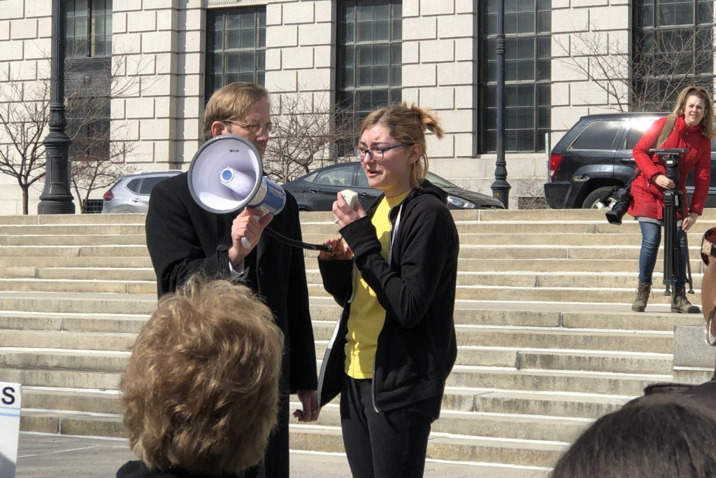 student speaking into a bullhorn