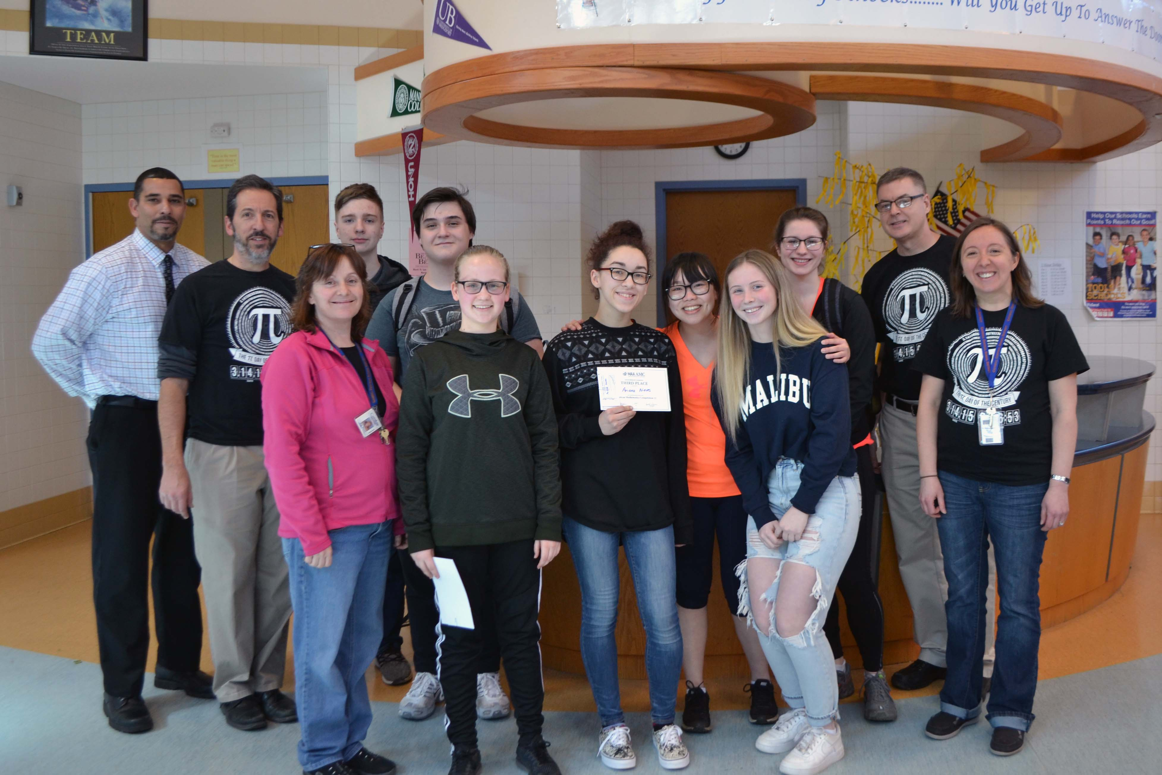 Catskills top finishers and math facuty pose for picture in High School lobby