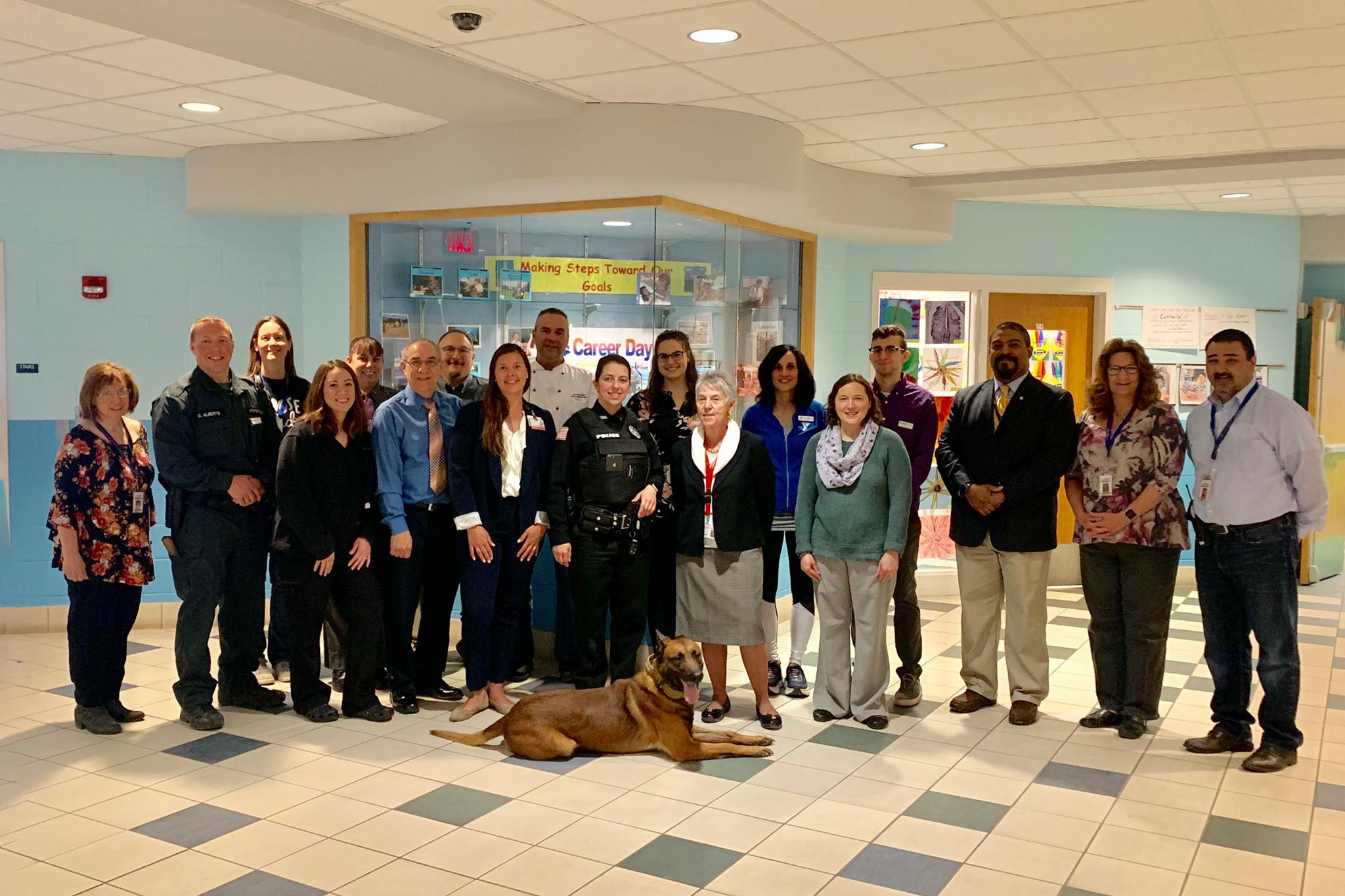 group photos of career presenters with school officials