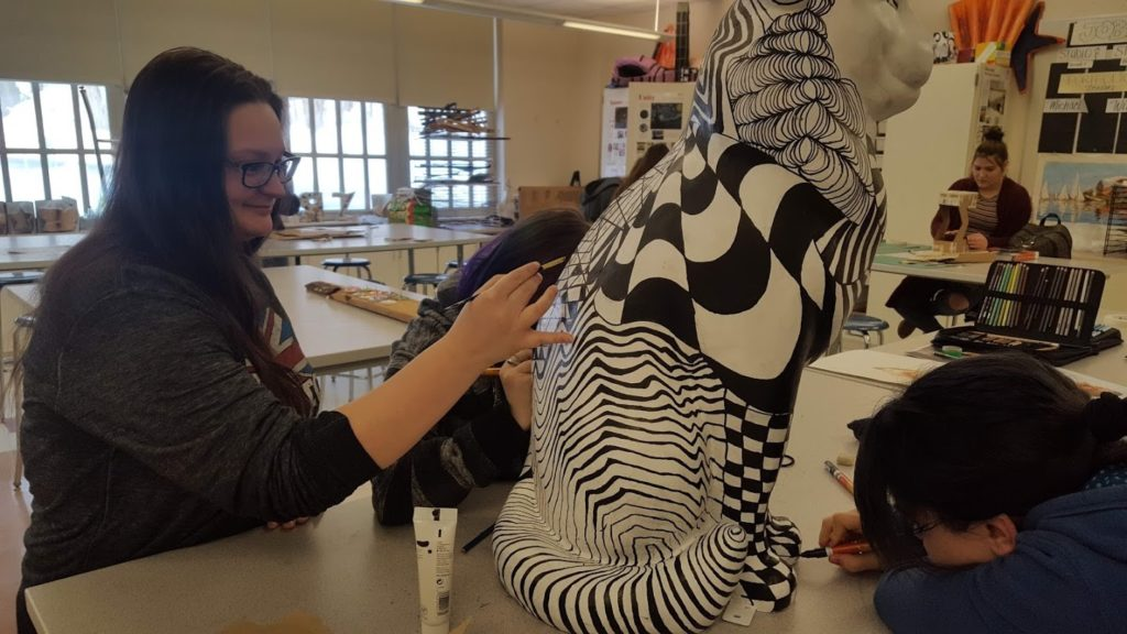 students put finishing touches on cat