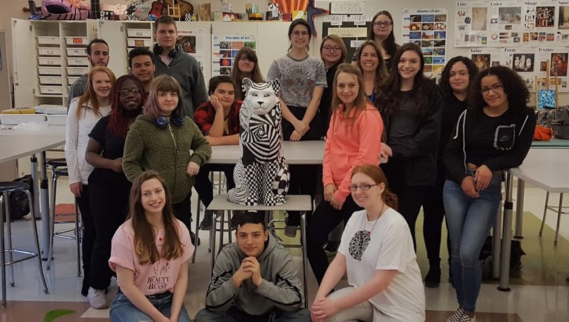 Students pose with finished cat