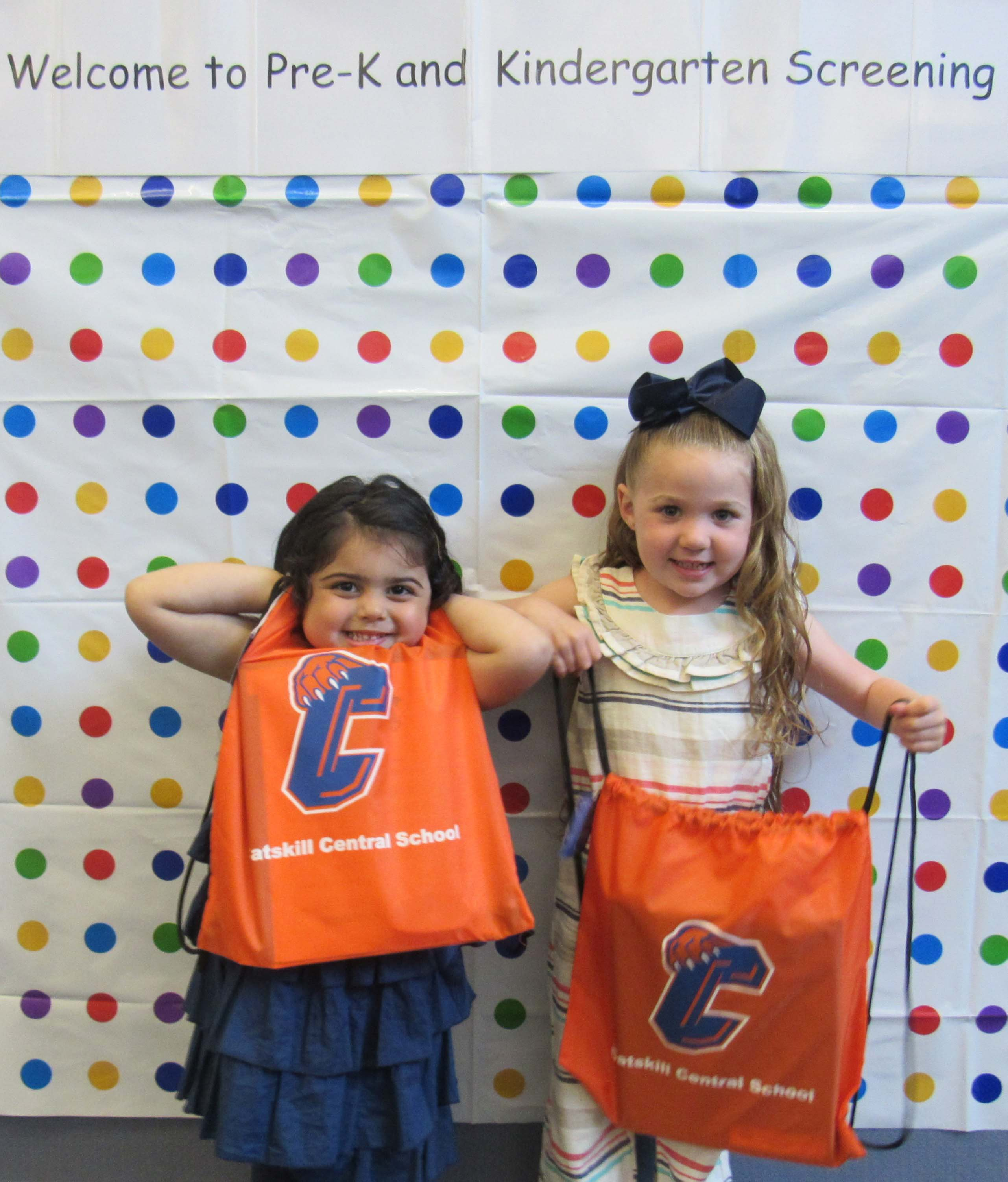 two girls holding Catskill CSD bags